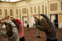 Participants stretch before learning new techniques at the self-defense seminar in Baker Center on Monday.