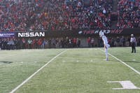 Michael Farkas awaits the snap before a punt in Ohio's 24-21 loss to Northern Illinois on Saturday.