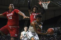 Ohio's Teyvion Kirk (#4) moves the ball from Miami's Bam Bowman (#14) and Dalonte Brown (#13) during the first half of the game on Friday at The Convo.