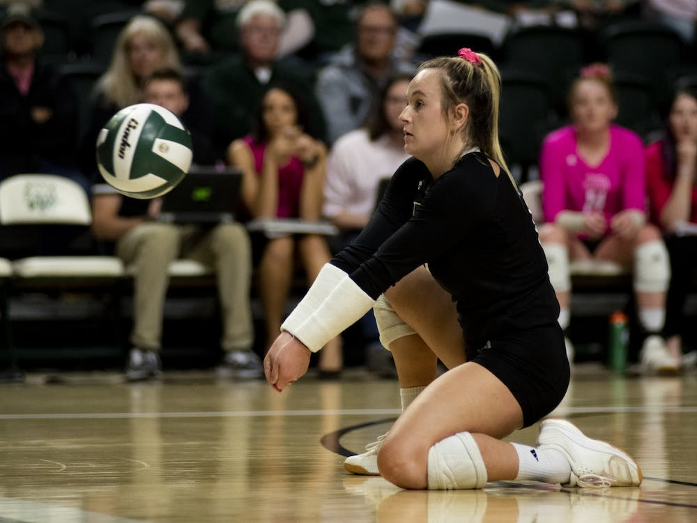 Ohio University libero, Macy Reihing (#18), passes the ball during the home game against Ball State. (FILE)