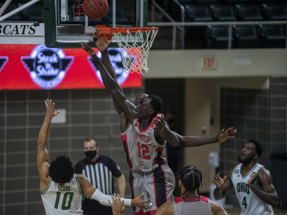 Ohio University freshman guard, Mark Sears (10), attempts a shot with heavy pressure from Northern Illinois University's, Zool Kueth (12) during the home game on Tuesday, Jan. 5, 2021 in Athens, Ohio.