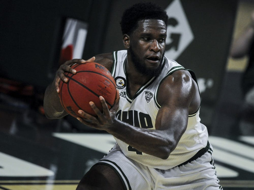 Ohio University senior, Dwight Wilson III (4), grabs a pass during the home game against Northern Illinois University on Tuesday, Jan. 5, 2021 in Athens, Ohio.