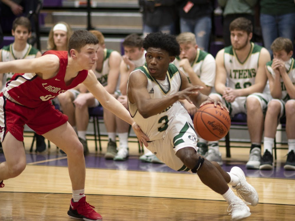 Elijah Williams drives to the hoop in Athens game versus Logan Elm on Friday, February 22, 2019.