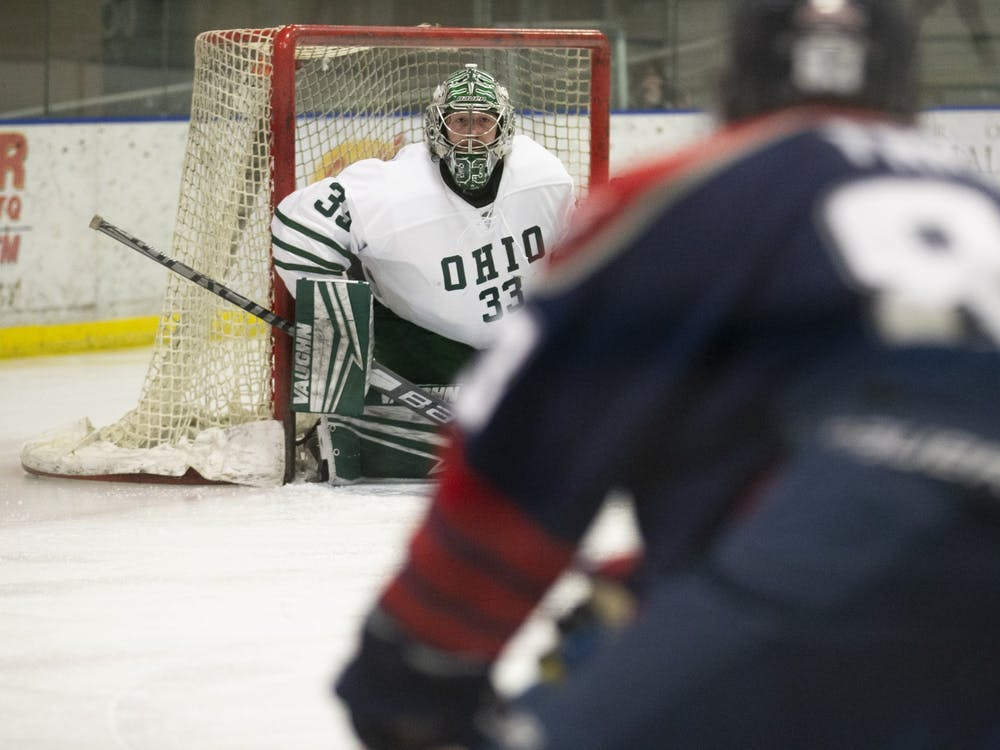 Ohio goalie Matt Server (#33) makes a save during the Ohio Bobcats game against the Liberty Flames on Friday, March 5, 2021, at the Bird Arena in Athens, Ohio