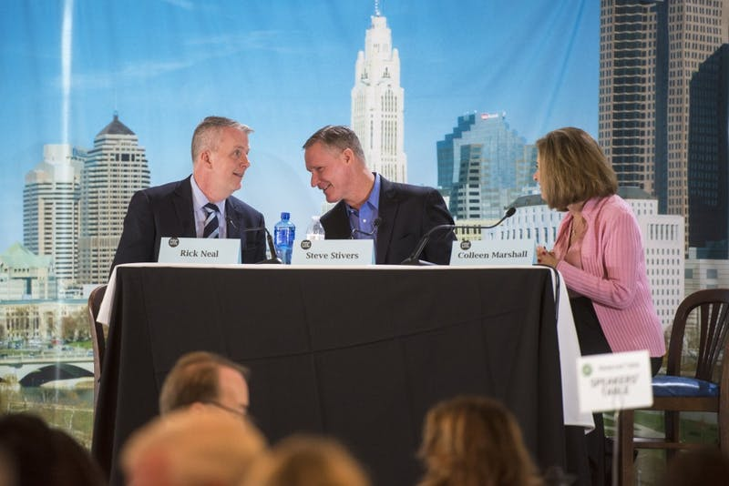 Candidates for Ohio's 15th Congressional District in the U.S. House Rick Neal (left) and Steve Stivers (right) talk to each other before their debate on Oct. 22, 2018 at The Boat House Restaurant in Columbus.