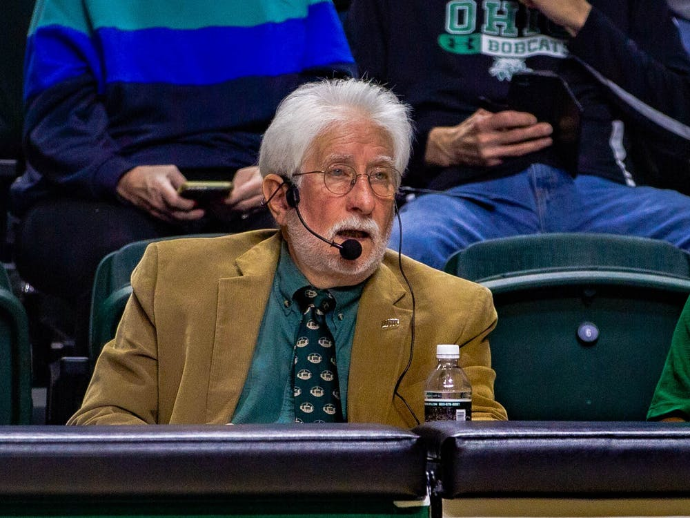 Pa announcer Lou Horvath gives advertisements during the OU v. Central Michigan University basketball game, as he does for many other sports, on Tuesday, Feb. 18, 2020.
