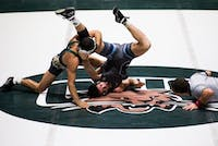 Ohio's Spartak Chino throws Old Dominion University's Austin Eads on the mat during a match Sunday at the Convocation Center. Ohio won 25-13 for its fifth straight victory.