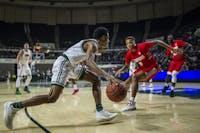 Junior, Antonio Cowart Jr. (#23), drives towards the basket against Radford on Saturday, December 8, 2018.