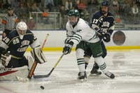 Ohio forward Drew Magyar (25) fights for a rebound during the Bobcats' hockey game against John Carroll on Friday, Sept. 27, 2019, at Bird Arena in Athens, Ohio.