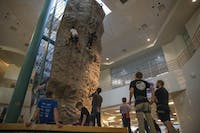 Climbers gather at the rock wall at the Ping Recreation Center.
