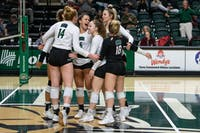 Ohio volleyball players celebrate a scored point during the game against Kent State on Thursday, November 7, 2019, in The Convo. Ohio won the match 3-0.