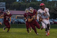 Alexander's QB Xander Karagosian (#8) runs the ball in the first quarter of the match against the Vikings at Vinton County High School in McArthur, Ohio, on Friday, Sept 25, 2020.  Alexander will face a sweeping defeat against VCHS with a final score of 31-0.