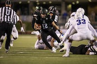 Ohio quarterback Nathan Rourke runs the ball during the first half of the Bobcats' game against Buffalo on Wednesday night.