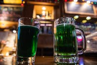 Green beer sits on the counter at Lucky's during Green Beer Day on March 6.