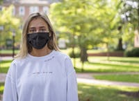 """Annie Muscarella, Ohio University student and founder of """"In fear of x"""" poses for a portrait on College Green on Sept. 16, 2020 in Athens, Ohio."""