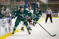 Ohio's Austin Heakins (#9) watches the puck during its game against Robert Morris-Illinois on Friday, Nov. 30. The Bobcats won 3-1.