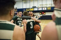 Brody Ball embraces his coach, Mickey Cozart, after scoring his 1001st point in high school at Wellston High School on January 13th, 2016 STAFF PHOTOGRAPHER|MATT STARKEY