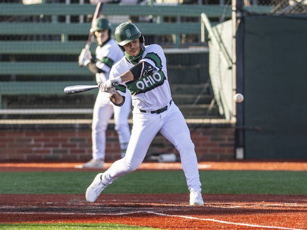 Ohio's Sebastian Fabik swings to hit the ball during the Ohio versus Wisconsin-Milwaukee game on Friday, March 5, 2021. The Bobcats won 14-3.