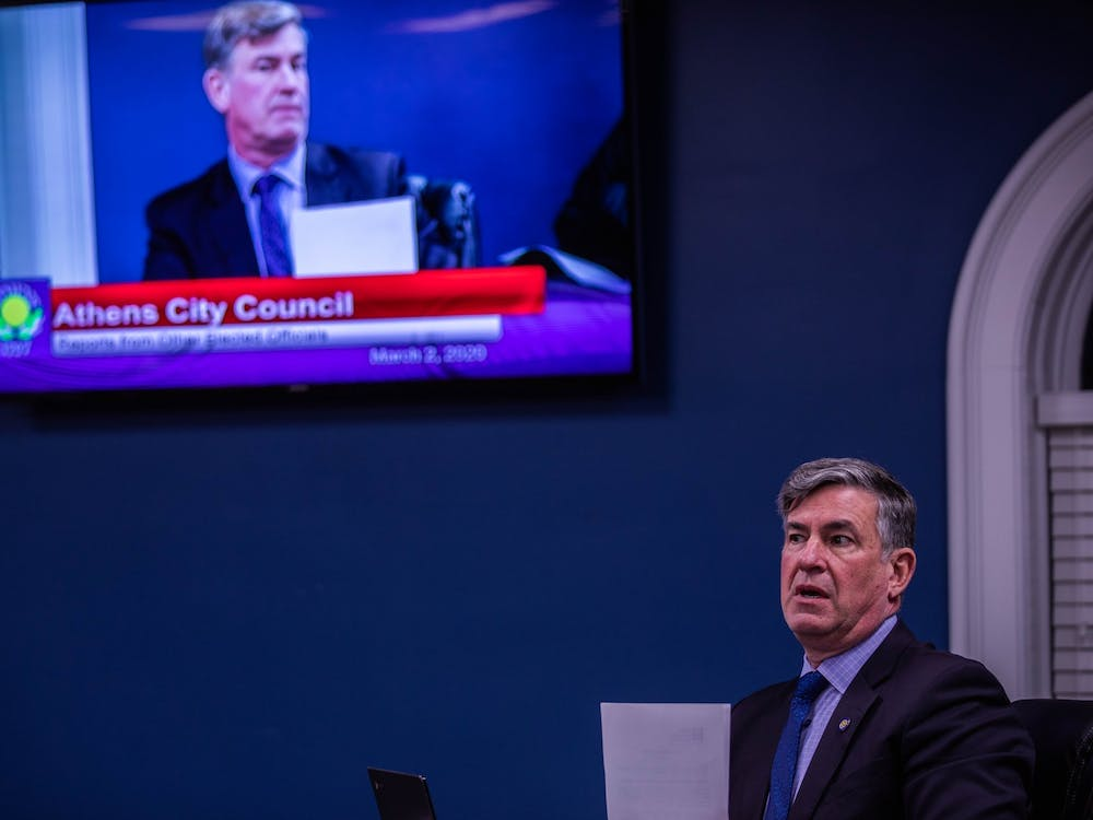 Athens Mayor Steve Patterson presents tips and precautions for the City of Athens to take in wake of the rapidly-spread Coronavirus across the country at the Athens City Council meeting on Monday, March 2, 2020.