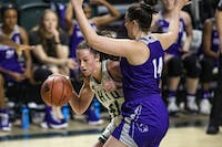 Ohio forward Gabby Burris (#41) attempts to drive past High Point forward Shea Curran (#14) during the first quarter of the Bobcats game against the Panthers on Thursday at the Convo. The Bobcats won by a score of 81-74.
