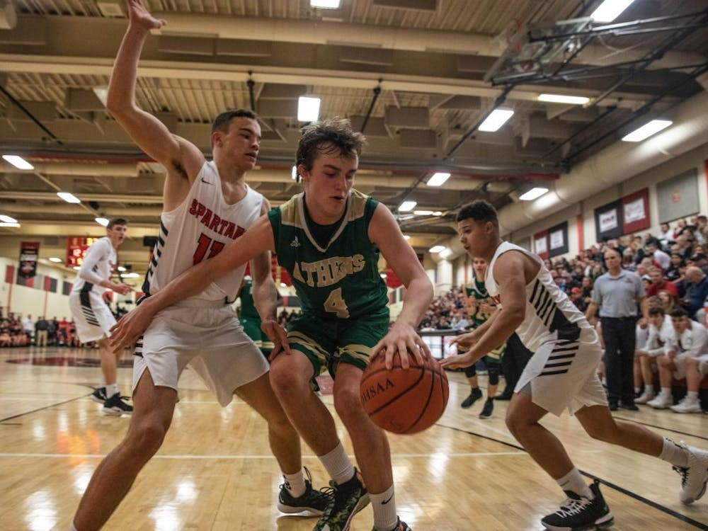 Athens forward Brayden Markins plays against Alexander in a conference game on Feb. 2. (FILE)