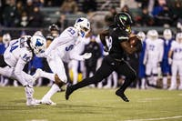 Ohio wide reciever Jerome Buckner (no. 8) sprints away from the Buffalo secondary en route to a second quarter touchdown during the Ohio Bobcats football game against the Buffalo Bulls on November 14, 2018.
