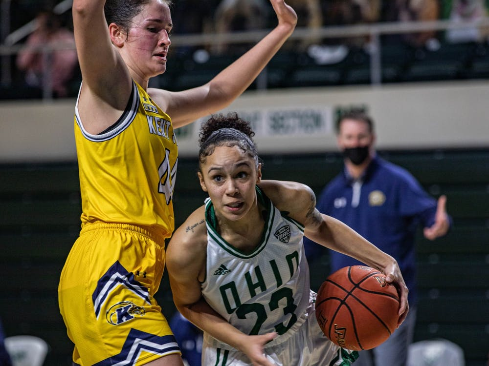Ohio guard Jasmine Hale (#23) plays through Kent State forward Lindsay Thall (#44) in a match held at the Convocation Center on Wednesday, Feb. 3, 2021.