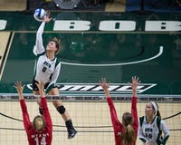 Mallory Salis (6) spikes the ball against Miami in the Convocation Center on November 4, 2016. MATT STARKEY | FOR THE POST