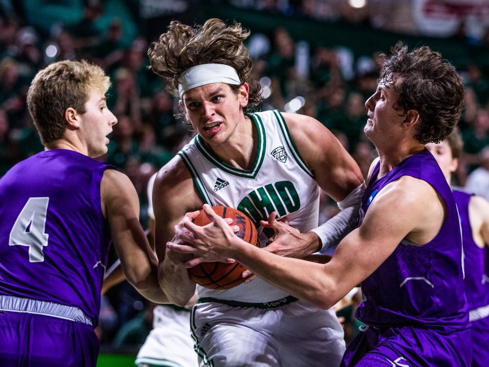 Ohio's F Ben Vander Plas (5) runs past Capital's W Trey Meister (4) and forward Will Hannah (11) in the first game of the season at the Convocation Center on Saturday, Nov. 2, 2019.