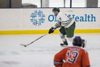Ohio freshman forward Zach Frank (#21) skates toward the goal during the Bobcats' game against Illinois in the quarterfinals of the ACHA Tournament on Sunday. The Bobcats lost 4-3 in overtime to the Fighting Illini.