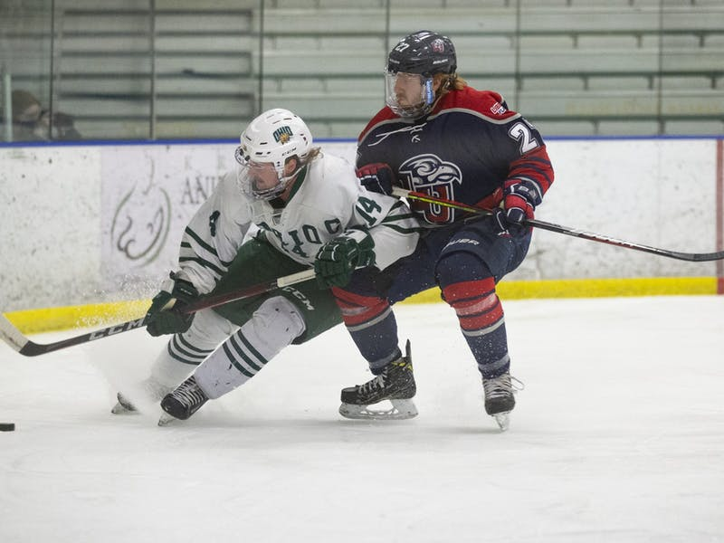 Ohio defenseman Shawn Baird (#14) chases down the puck during the Ohio Bobcats game against the Liberty Flames on Friday, March 5, 2021, at the Bird Arena in Athens, Ohio