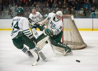 Ohio goalie Jimmy Thomas (#30) clears the puck during the Bobcats' game against Iowa State on Saturday, Feb. 16. (FILE)