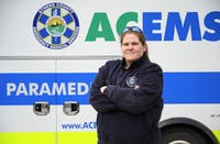Lt. Kayce Carrick poses for a portrait by an ACEMS vehicle at their station on West Union Street on Thursday, March 7.
