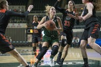 Ohio's Taylor Agler tries to protect the ball from Bowling Green's defense during the game against Bowling Green on Feb. 17, 2018. Ohio beat Bowling Green 68-58. (FILE)