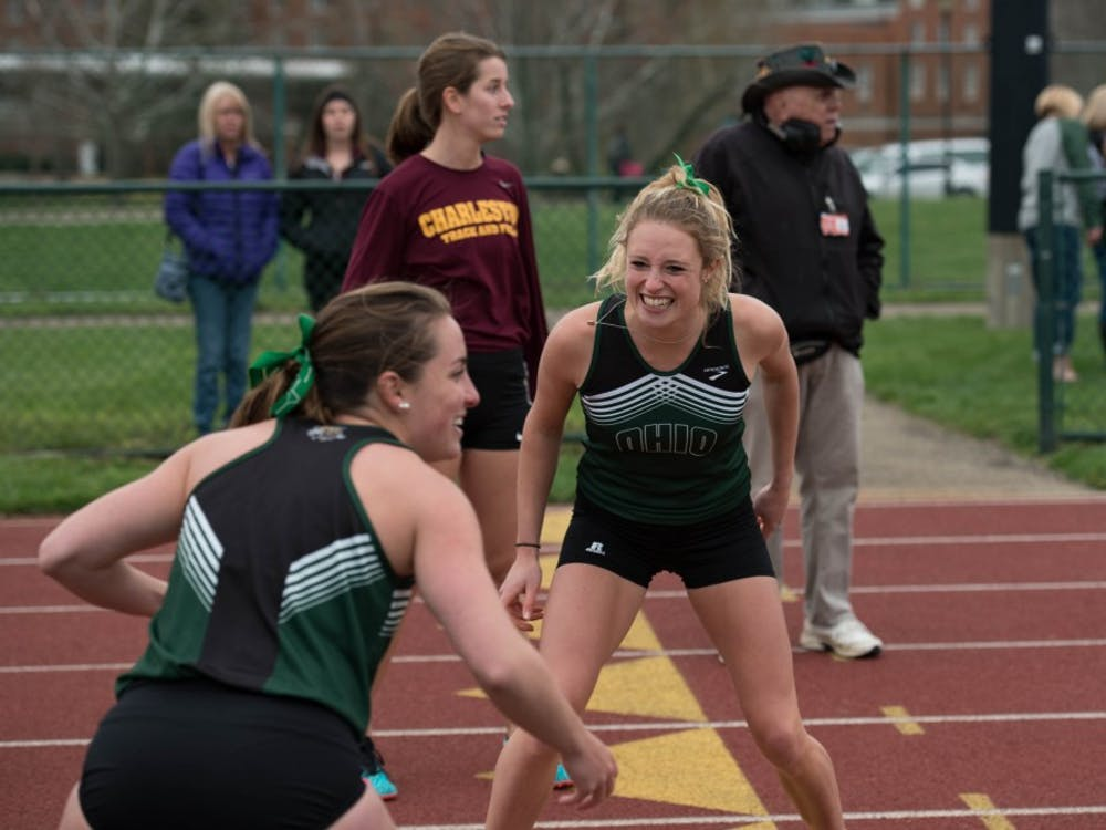 Rebekah Markovitz taunts and teases Emily Deering as the two teams compete in the 4x400M race during Ohio's Cherry Blossom invitational on Saturday April 1, 2018. (BLAKE NISSEN | FILE)