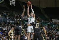 Ohio forward Ben Vander Plas shoots with pressure from Western Michigan forward Chase Barrs on Tuesday, Feb. 11, 2020 in The Convo.