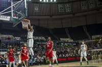 Doug Taylor finishes a dunk in Ohio's win over Radford on Saturday at The Convo.