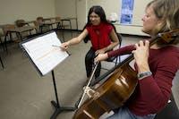 Aleksandra Pereverzeva, a third-year graduate student studying music performance and pedolgogy, gives cello lessons Thursday to Lynn Petrik in Glidden Hall.