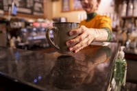 Athens businesses provide incentives for customers to practice sustainability, such as Donkey Coffee, which offers a discount to customers who bring their own reusable mug.