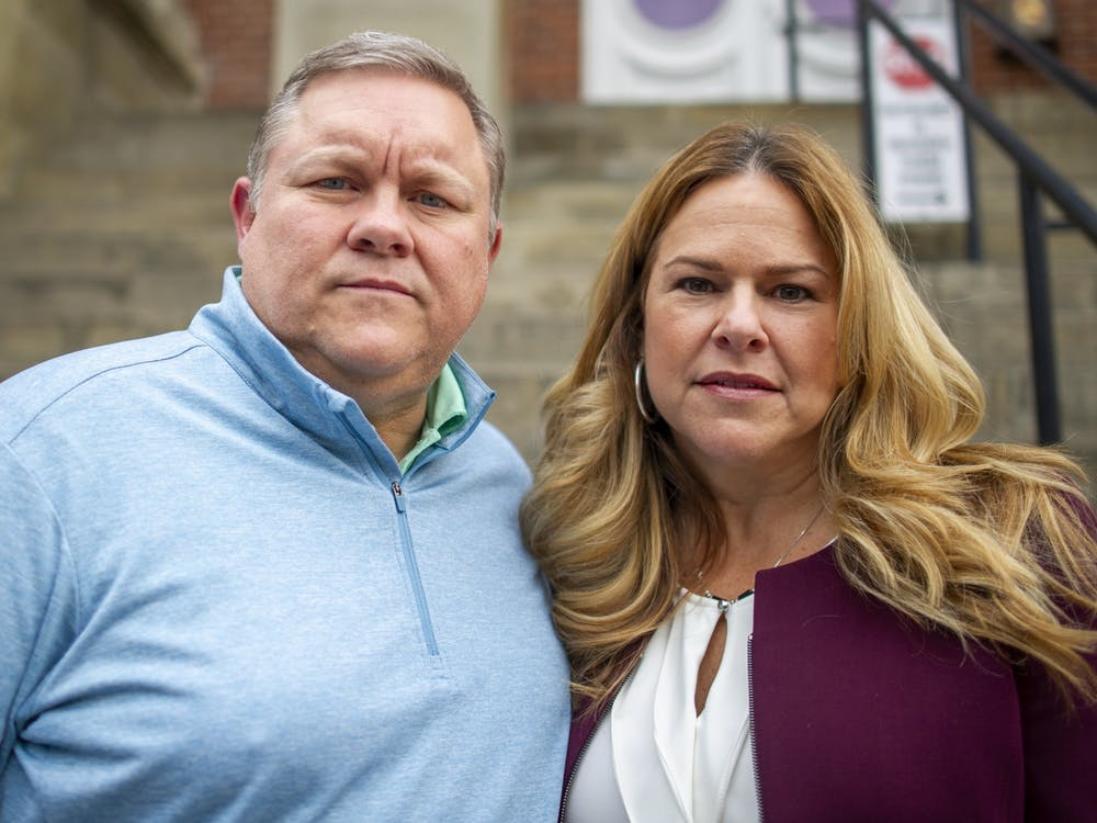 Kathleen and Wade Wiant, parents of Collin Wiant, pose for a portrait outside the courthouse in Athens, Ohio, on Thursday, Nov. 21, 2019.