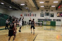 Isaiah Butcher shoots a three-pointer in the first quarter of Athens' 54-47 victory over Marietta Tuesday.