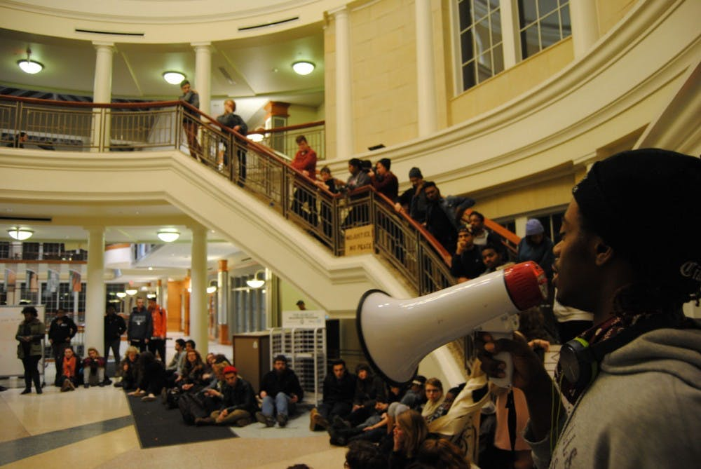 Students and locals protest after Michael Brown verdict