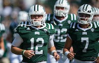 Ohio quarterback Nathan Rourke (left, #12) leads the Bobcats off the field during their game against Central Michigan on Oct. 7. (FILE)