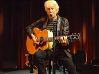 Graham Nash playing the guitar and singing. (Provided via Graham Nash's Facebook page)