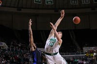 Buffalo guard CJ Massinburg (#5) blocks Ohio guard Connor Murrell (#10) from making a shot in a match held at the Convo on March 5, 2019.