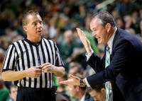 Ohio head coach Saul Phillips argues with a referee during the second half of the Bobcats' 85-70 win over Akron on Saturday, February 4 at the Convocation Center.