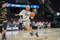 Ohio University's Cece Hooks (no.5) drives the ball against Eastern Michigan University during the MAC championship game in Cleveland, Ohio, at Rocket Mortgage Field House on March 11, 2020.