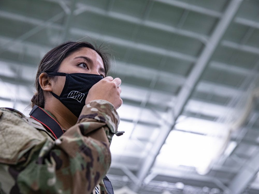 While adjusting her mask, Lang scans Walter Fieldhouse for her next photo to shoot  while working as the public affairs head for ROTC.
