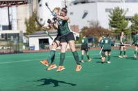 Ohio University field hockey seniors, Kendall Ballad and Karynne Baker, celebrate shortly before the start of their game against Ball State.