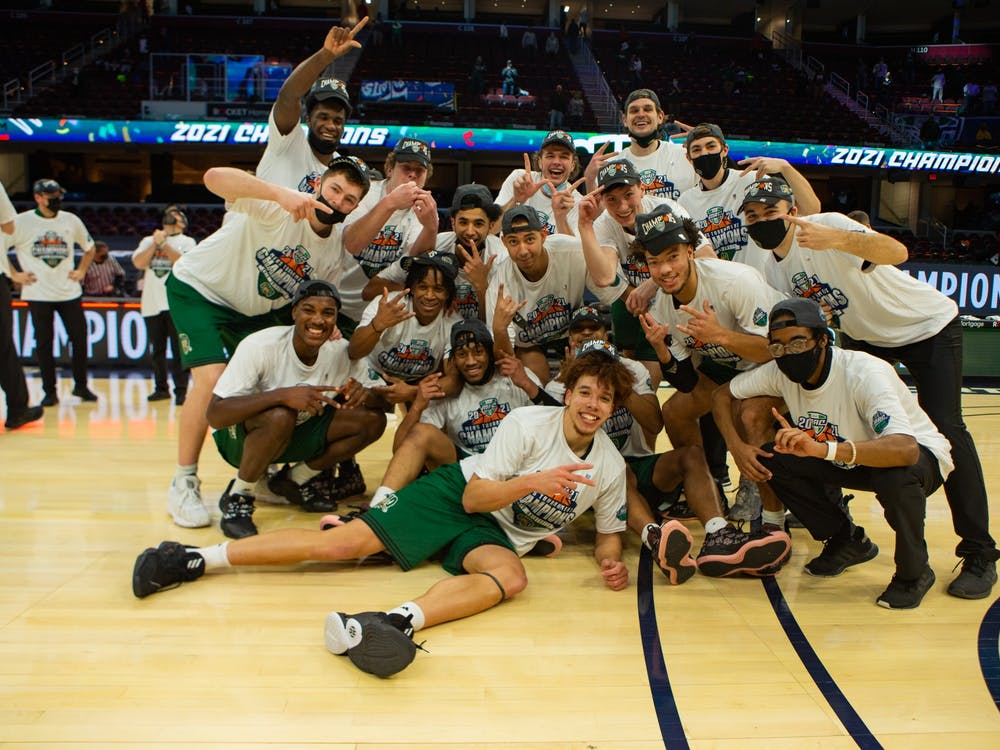 The Ohio Men's Basketball team celebrates winning the Mid American Conference Tournament Championship following an 84-69 victory over Buffalo at the Rocket Mortgage FieldHouse in Cleveland on Saturday March, 14 2021. (Mijana Mazur - Ohio Athletics)
